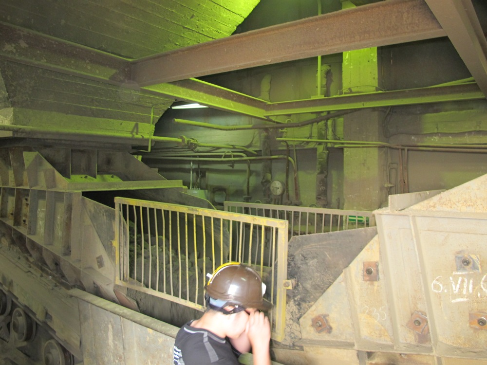 Ore is hauled up in skips which is then dumped into jaw crushers and then onto a conveyor system